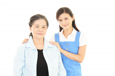 caregiver with an elderly woman smiling