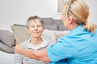 senior citizen in physiotherapy together with caregiver